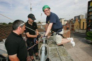 Photo of Tim Nurcombe on the roof of the Town Hall