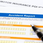 Motor or car insurance accident report form with pen
